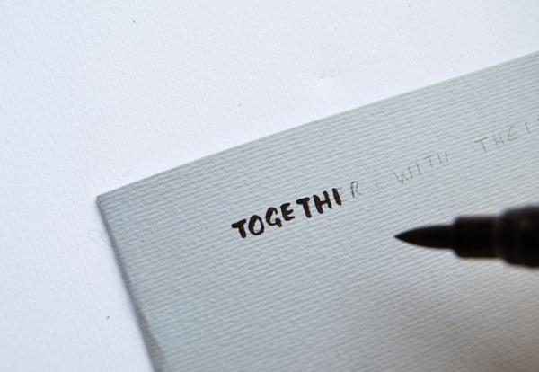 paper-cut-invite-calligraphy-in-capitals