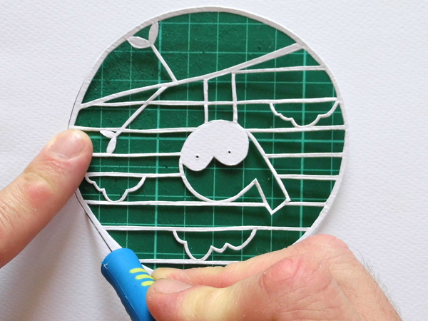 papercut bauble cutting the outside