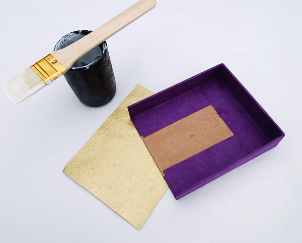 Glue the liners onto the inside of the trays