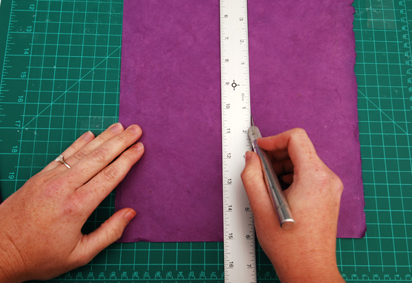 cut a piece of cover paper measuring 05cm smaller than your case on all sides