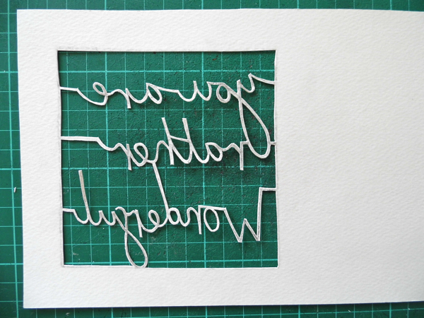 papercutting tricky letters cut out back view