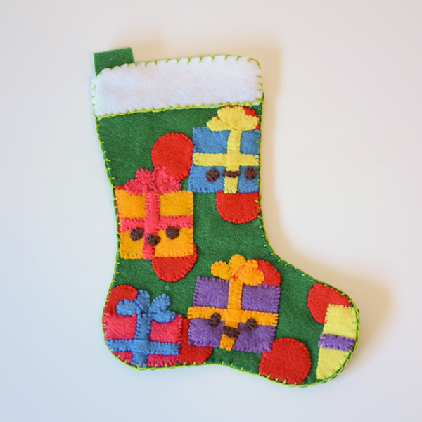 Sew a Christmas stocking for an easy way to add handmade decor to your home and a fun way to make something special for your family. This pattern makes a small stocking that fits just enough treats and goodies to bring smiles on Christmas morning! There are lots of ways to sew stockings, but this one is quick and easy.