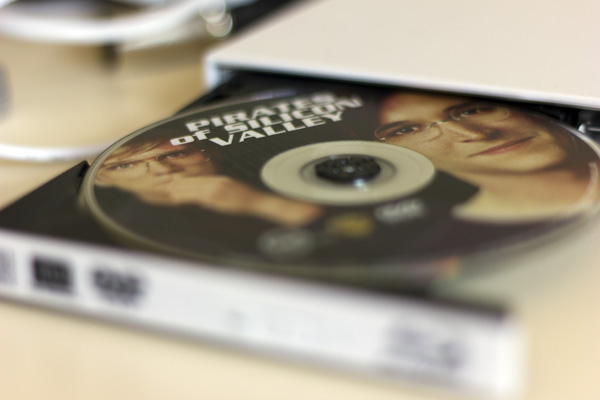 Inserting my copy of Pirates of Silicon Valley into my DVD drive